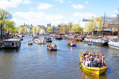 AMSTERDAM - APR 27: People celebrating Kings Day in Amsterdam on Royalty Free Stock Photos