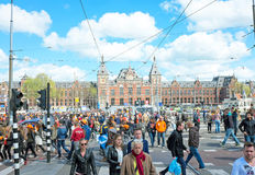 AMSTERDAM APR 27: People at the Central Station on Kings Day in Stock Photos