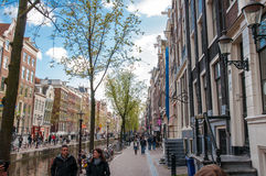 Amsterdam-April 30: Amsterdam's Red Light District, tourists go sightseeing on April 30,2015, the Netherlands. Royalty Free Stock Photos