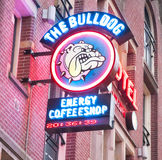 AMSTERDAM-APRIL 27: Amsterdam Bulldog coffeeshop sign-board in red-light district on April 27,2015, the Netherlands. Royalty Free Stock Photos
