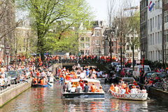 AMSTERDAM - APRIL 30: Amsterdam canals full of boats and people Stock Photography