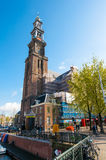 AMSTERDAM-APRIL 30: The belfry of the Westerkerk from the Prinsengracht canal on April 30,2015, the Netherlands. Royalty Free Stock Photography