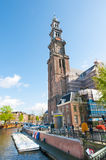 AMSTERDAM-APRIL 30: The bell tower of the Westerkerk as seen from the Prinsengracht canal on April 30,2015, the Netherlands. Stock Photos