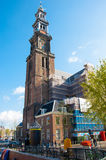 AMSTERDAM-APRIL 30: The bell tower of the Westerkerk seen from the Prinsengracht canal on April 30,2015, the Netherlands. Stock Photo