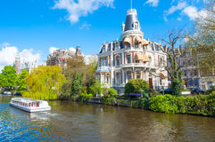 Amsterdam-April 30: Boat Cruising on Amsterdam Singelgrachtkering Canal on April 30,2015, the Netherlands. Stock Image