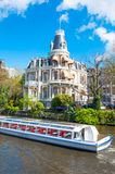 Amsterdam-April 30: Boat Cruising on Amsterdam Singelgrachtkering Canal on April 30,2015. Stock Photography