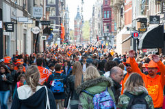 AMSTERDAM-APRIL 27: Busy Amsterdam street during King's Day on April 27,2015 in Amsterdam, the Netherlands. Royalty Free Stock Photo