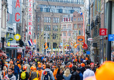AMSTERDAM - APRIL 30: City natives and tourists celebrate Queen' Stock Photos