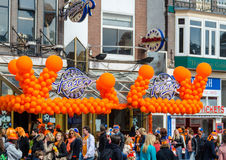 AMSTERDAM - APRIL 30: City natives and tourists celebrate Queen' Royalty Free Stock Image
