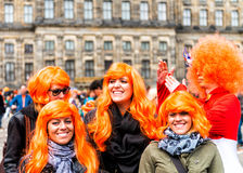AMSTERDAM - APRIL 30: City natives and tourists celebrate Queen' Royalty Free Stock Photos