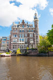 Amsterdam-April 30: Cosy house on the Singelgrachtkering Canal on April 30,2015, the Netherlands. Royalty Free Stock Photo
