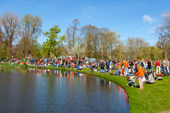 AMSTERDAM-APRIL 27: Crowd of locals and tourists in orange celebrate King's Day in on April 27,2015 in Vondelpark. Stock Photos