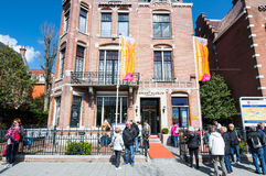 AMSTERDAM-APRIL 30: The Diamond Museum Amsterdam, group of tourists on the street on April 30,2015, the Netherlands. Royalty Free Stock Photography