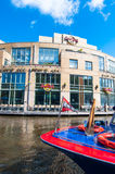 AMSTERDAM-APRIL 30: Hard Rock Cafe on the Singelgrachtkering Canal with boat on April 30,2015. Royalty Free Stock Image