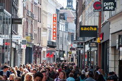 AMSTERDAM-APRIL 30: Kalverstraat shopping street in the midday, people go shopping on April 30,2015. Royalty Free Stock Photos