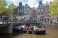 AMSTERDAM-APRIL 27:  King's Day boating through  Amsterdam canals on April 27, 2015, the Netherlands. Stock Photography