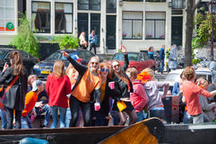AMSTERDAM-APRIL 27:  King's Day boating, youth have fun on the boats on April 27, 2015 in Amsterdam, the Netherlands. Stock Photos