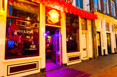 AMSTERDAM-APRIL 27: Local restaurant in red light district invites guests to have dinner on April 27,2015, the Netherlands. Royalty Free Stock Image