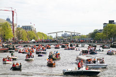 AMSTERDAM - APRIL 30: Lots of boats partying on the river Amstel Stock Photography