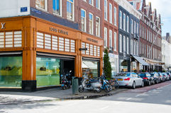 AMSTERDAM-APRIL 30: Louis Vuitton store on the P.C.Hooftstraat shopping street on April 30,2015 the Netherlands. Royalty Free Stock Photos