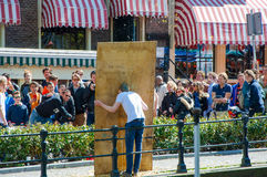 AMSTERDAM-APRIL 27: People look at throwing eggs in the face (Amsterdam amusement) during King's Day on April 27,2015. Stock Photo