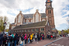 AMSTERDAM-APRIL 30: People and tourists stand in a queue to Anne Frank House Museum on April 30,2015. Royalty Free Stock Photos
