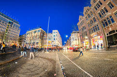 AMSTERDAM - APRIL 25, 2015: Tourists and locals in Dam Square at Royalty Free Stock Images