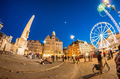 AMSTERDAM - APRIL 25, 2015: Tourists and locals in Dam Square at Stock Photography