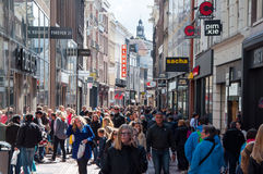 AMSTERDAM-APRIL 30: Undefined people on Kalverstraat shopping street on April 30,2015, the Netherlands. Stock Image