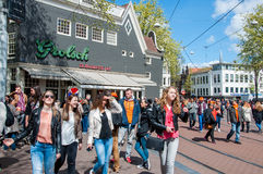 AMSTERDAM-APRIL 27: Young people celebrate the King's Day on Amsterdam street on April 27,2015, the Netherlands. Stock Photography