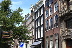 Amsterdam with architecture and city signs stock photography