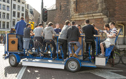 Amsterdam beer bike pub crawl. Amsterdam, The Netherlands - April 05, 2014; Brand new attration in Amsterdam. The beer bike in combination with a pub crawl. With Royalty Free Stock Photo