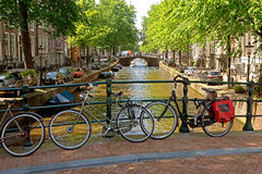 Amsterdam - Bicycles on a bridge over the canal Royalty Free Stock Photography