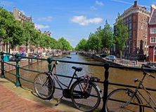 Amsterdam - Bicycles on a bridge over the canal Stock Photos
