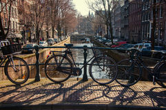 Amsterdam. Bicycles parked on a bridge in Amsterdam Royalty Free Stock Image