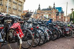 Amsterdam Bicycles parked on street stock photos