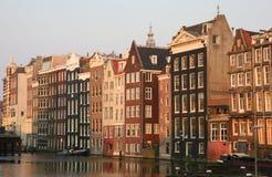 Amsterdam bij zonsondergang stock afbeeldingen