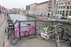 Amsterdam. With bikes canal and traditional buildings Stock Photos