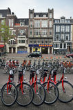 Amsterdam bikes on empty street Royalty Free Stock Photo