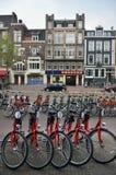 Amsterdam bikes on empty street Royalty Free Stock Photo