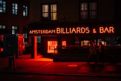 Amsterdam Billiards & Bar neon sign at night, in the East Village, Manhattan, New York City.  stock image