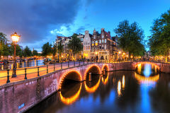 Amsterdam blue hour canals. Beautiful cityscape of the famous canals of Amsterdam, the Netherlands, at night with bridges at the Emperor`s canal keizersgracht Royalty Free Stock Photography