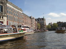 Amsterdam. The boat while sailing through one of the Amsterdam canals Stock Photos