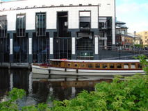 Amsterdam. The boat while sailing through one of the Amsterdam canals Royalty Free Stock Image
