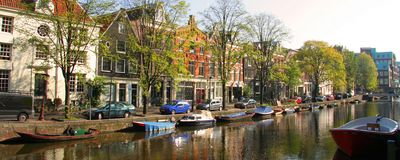 Canal in Amsterdam city. Panoramic view of boats on canal in Amsterdam city, Netherlands Royalty Free Stock Photography