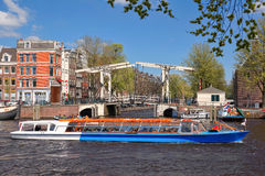 Amsterdam with boats on canal in Holland Royalty Free Stock Images