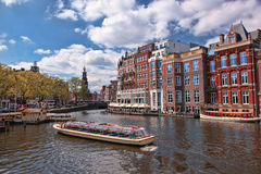 Amsterdam with boats on canal in Holland Royalty Free Stock Image
