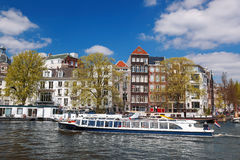 Amsterdam with boats on canal in Holland Royalty Free Stock Photo