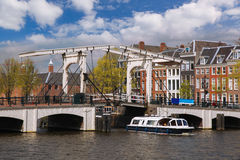 Amsterdam with boats on canal in Holland Stock Photography