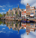 Amsterdam with boats on canal in Holland Stock Images